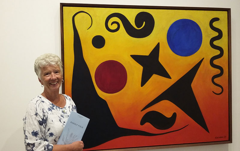 Anne posing in front of her favourite Calder art